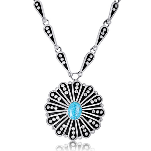 Kingman Turquoise circle pendant set in Sterling Silver by Navajo artist Jonathon Nez