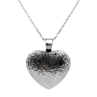 Heart necklace by Navajo artist Artie Yellowhorse