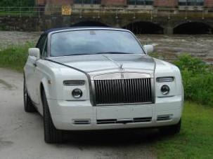 Really Regal Road Running in a Rolls Royce