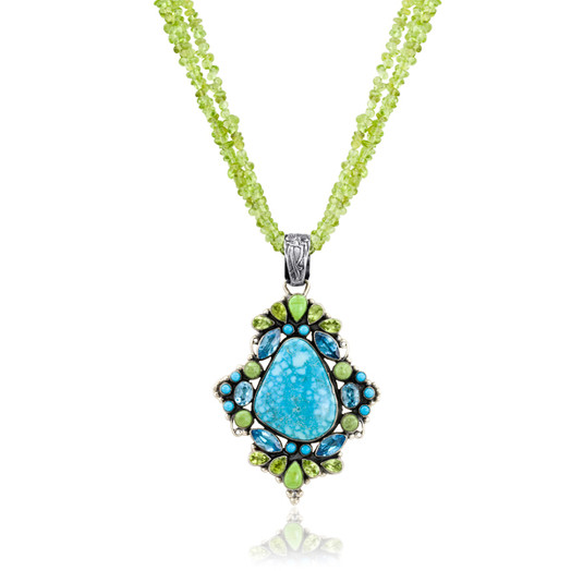 Kingman Turquoise pendant surrounded with Gaspeite, faceted Peridot and Blue Topaz, with Sleeping Beauty accents on Peridot beads