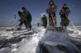 scrubbing the deck of contaminated USS R Reagan