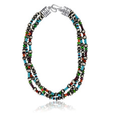 Handmade Sterling Silver beads interspersed with Turquoise, Spiny Oyster and Gaspeite by Navajo artist Josephine Geneva