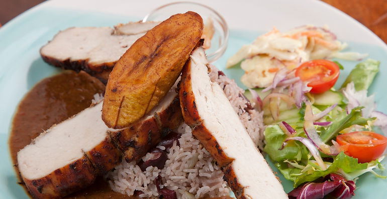 Jerk Chicken served with rice and peas_e