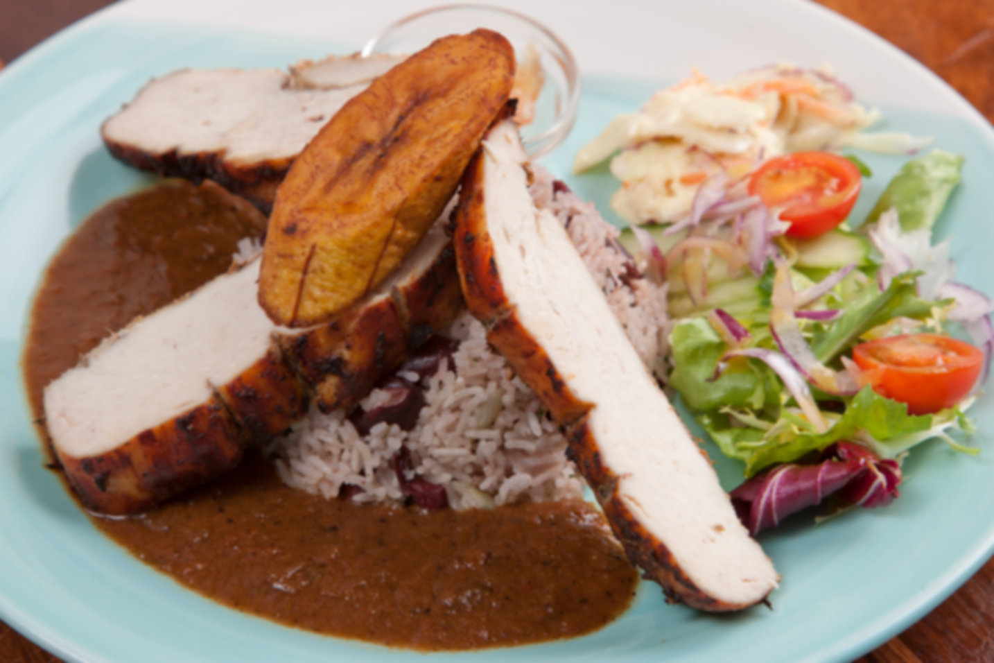 Jerk Chicken served with rice and peas