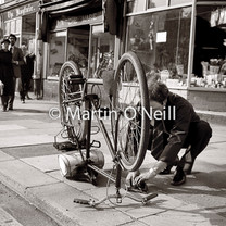A man fixes a puncture on his bike