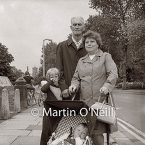 Grandparents walk with their children