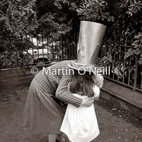 A loser in an Easter bonnet contest is consoled