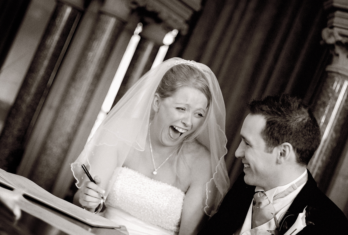 Bride signs register, Manchester