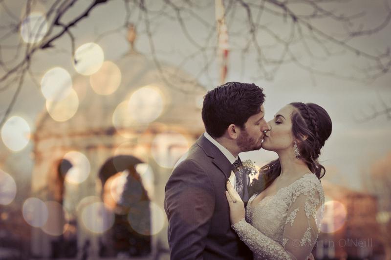 Bride, groom, kiss, US flag, gazebo