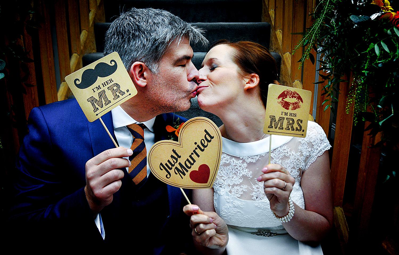 Bride, groom, kiss, signs
