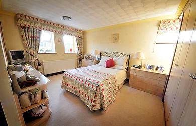Bedroom, bed, wardrobes, shelves