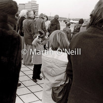 A boy watches aircraft from the terrace at Manchester airport