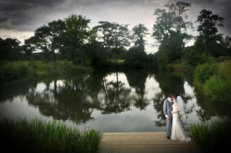 Bride, groom, lake