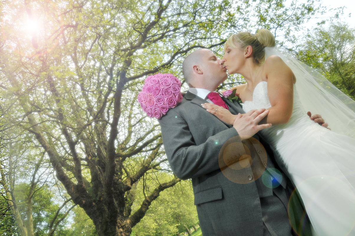 Couple kiss, wedding, Liverpool