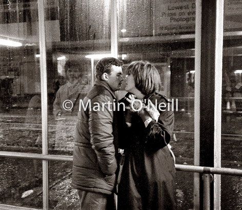 Young lovers in Piccadilly Bus station, Manchester