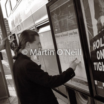 A man checks schedules in a bus shelter in Eccles