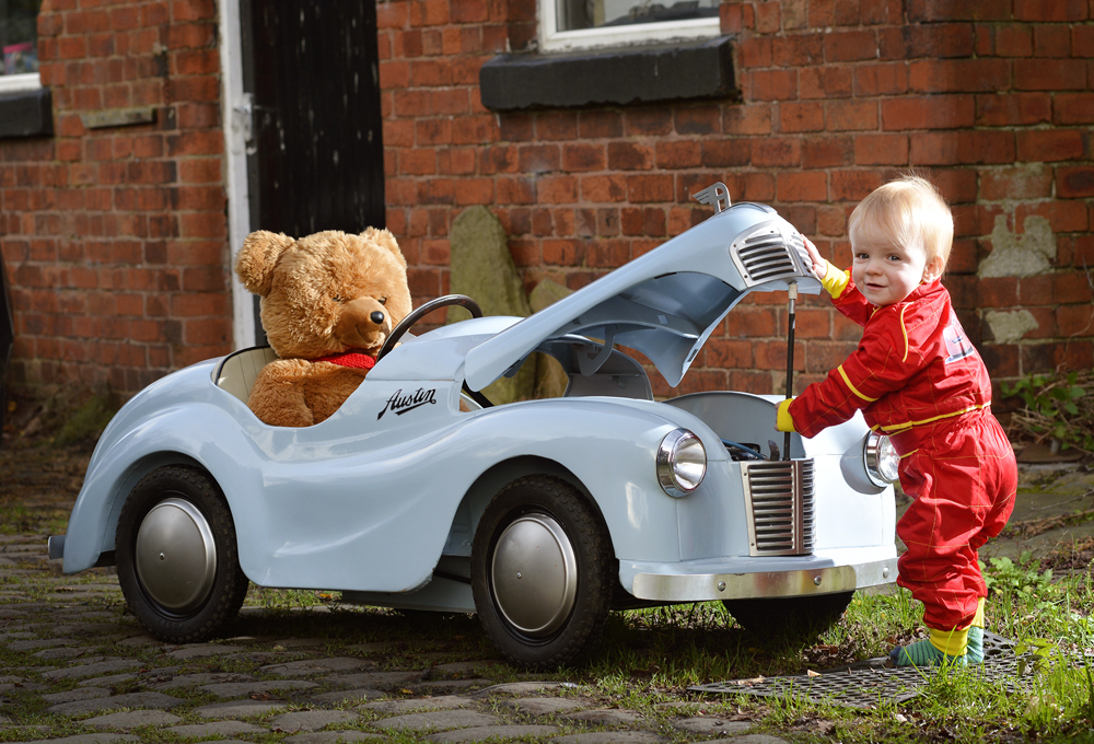 Young boy with toy car