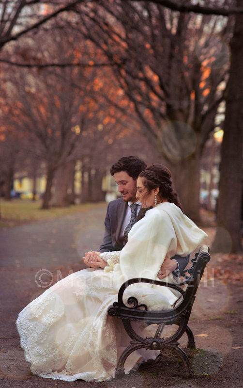 Bride, groom, wedding rings, park bench