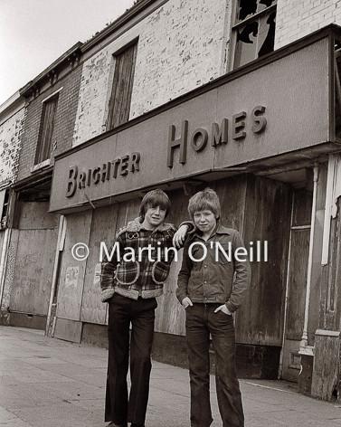 Boys outside derelict shop, Salford