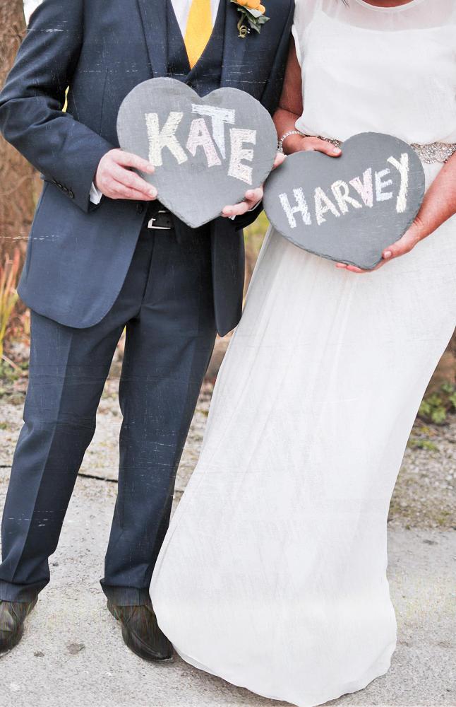 Bride, groom, slate