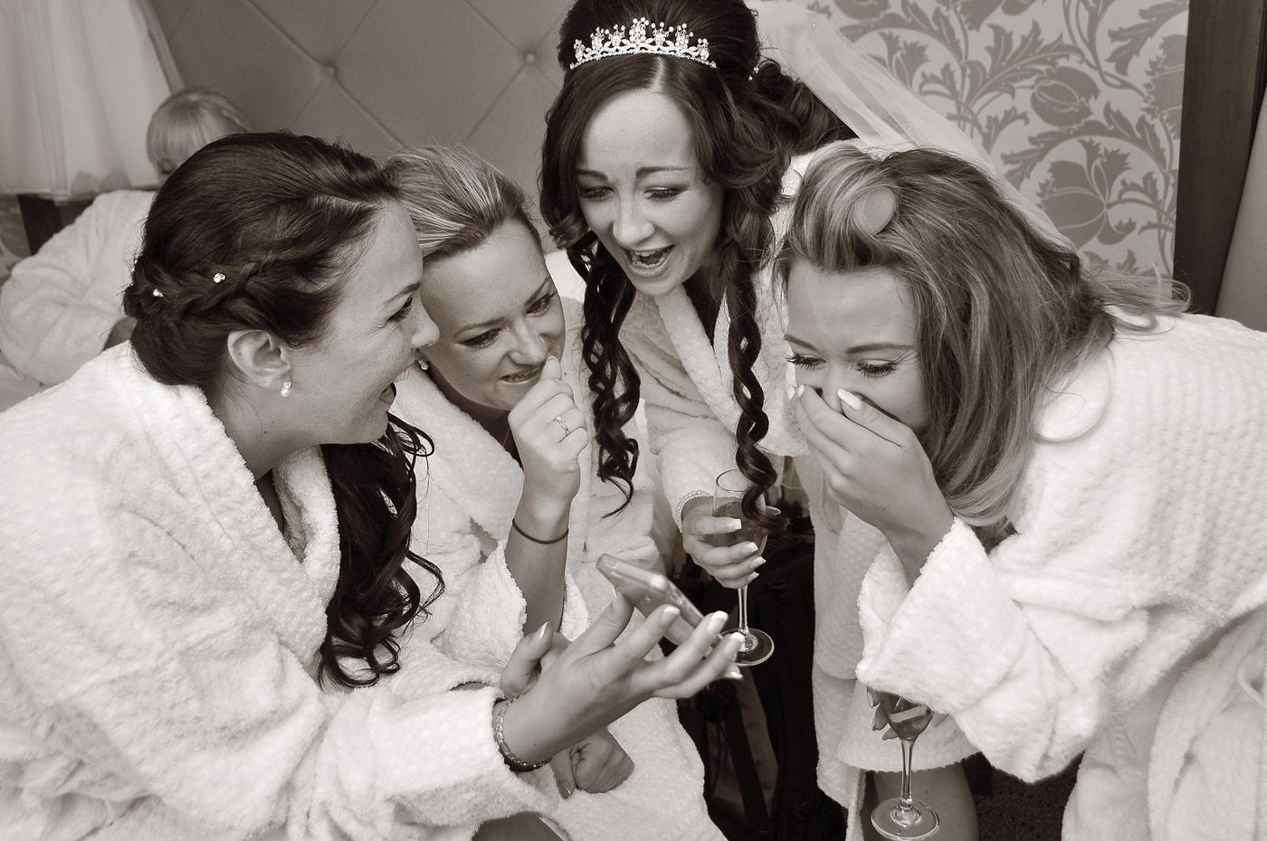 Bride, bridesmaids, phone