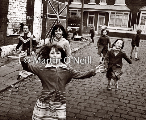Youngsters play in a Salford street
