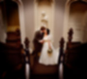 Bride and groom kiss on staircase
