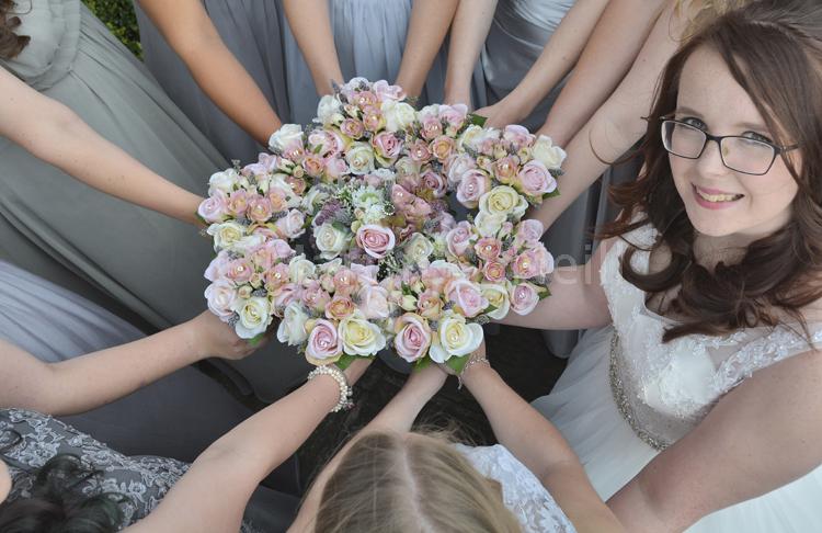 Bouquets, bridesmaids, bride