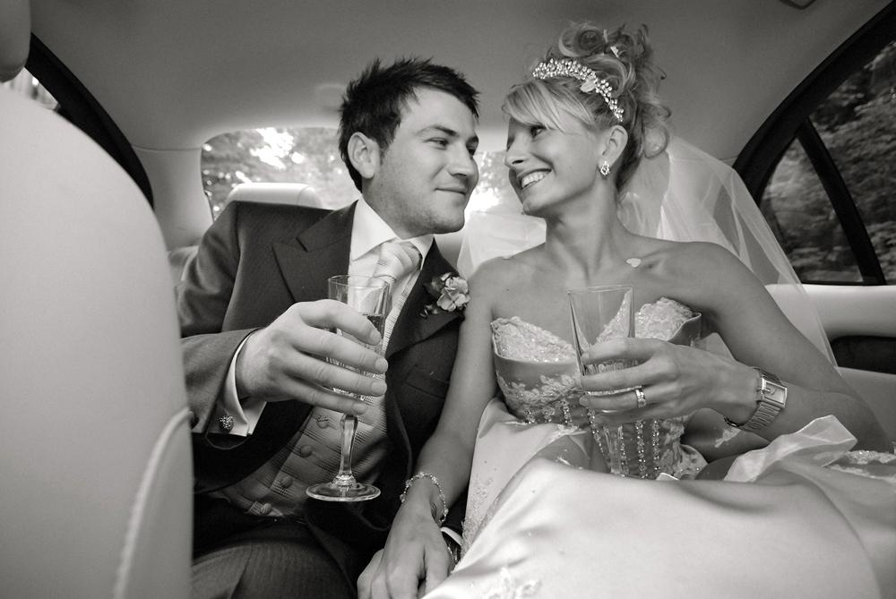 Bride and groom in car, wedding