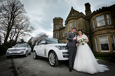 Bride, groom and wedding cars