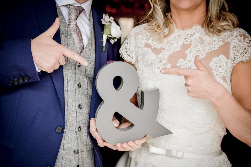Bride, groom, ampersand