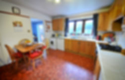 kitchen, dining table, work-surfaces, tiled floor