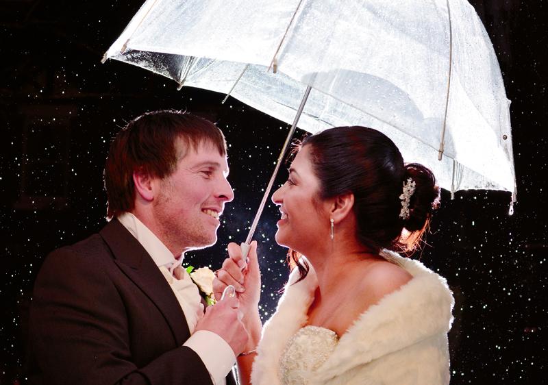 Bride, groom, umbrella, rain