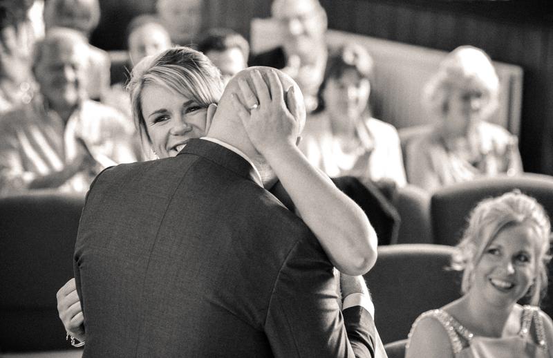 Bride hugs husband at altar