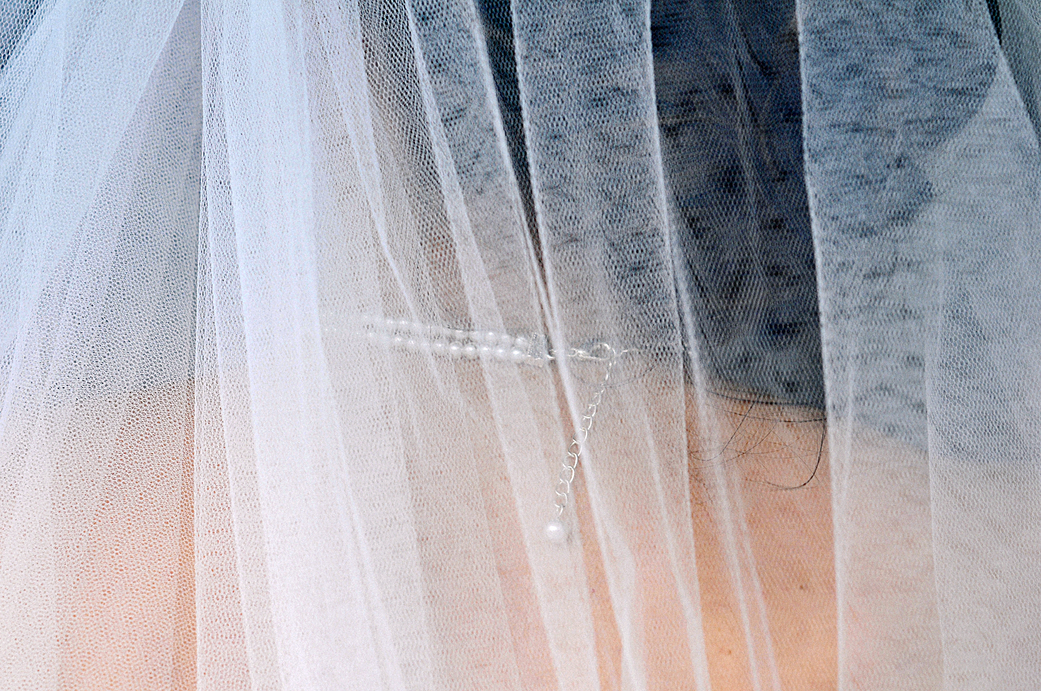 A wedding necklace and veil
