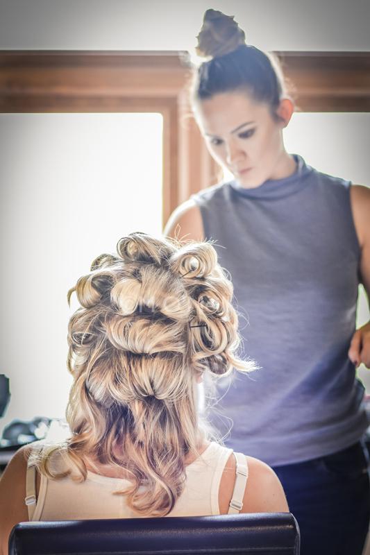 Bride has hair done before wedding