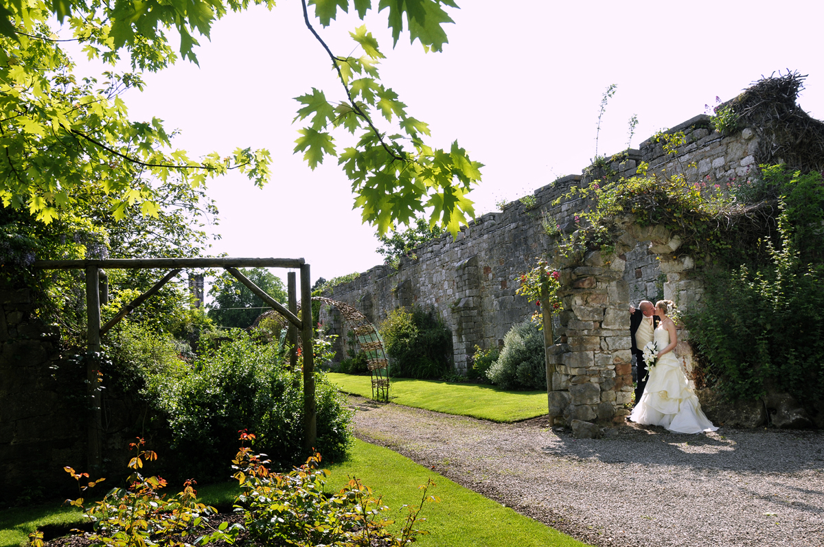 Bridal couple, garden, Wales