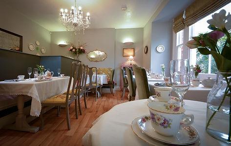 Cup, saucer, tea-shop, tables, chandelier