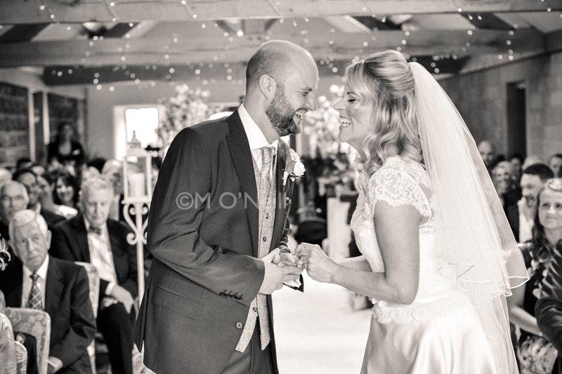Bride, groom laughing at wedding ver