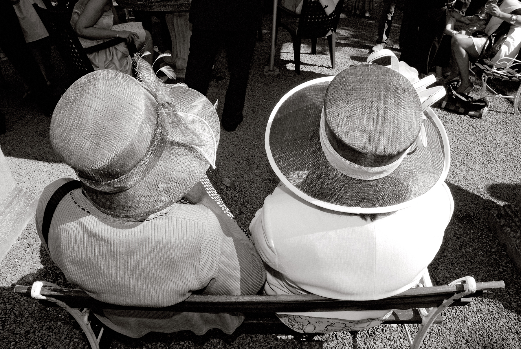 Two ladies wearing hats, wedding