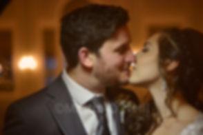 Bride, groom, kiss, hotel