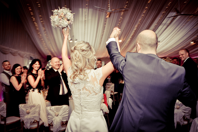 Bride and groom arrive at wedding