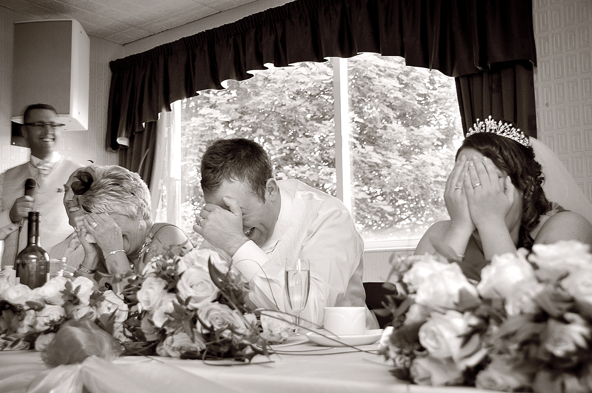 Groom hides face at speeches