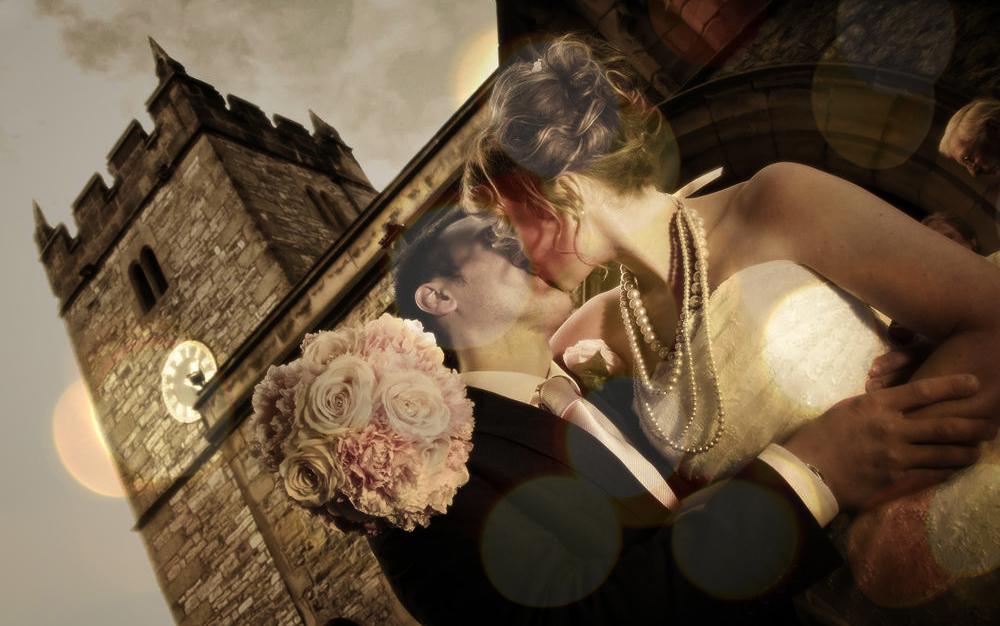 Bride and groom, kiss at church