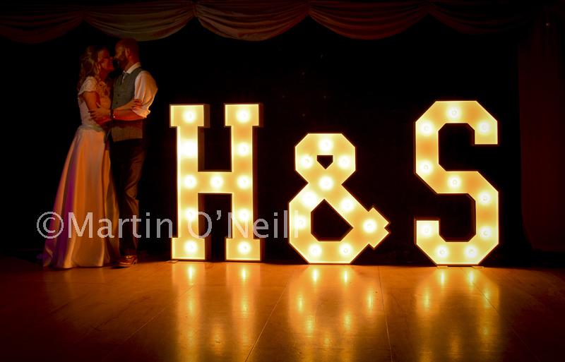 Bride, groom, giant letters