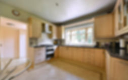 Kitchen, cooker, work-surfaces, tiled floor