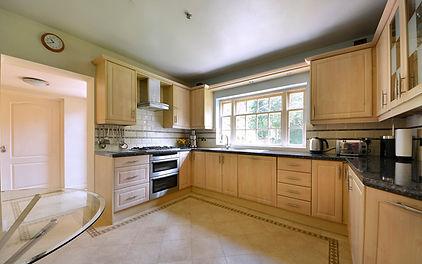 Kitchen, cooker, work-surfaces, tiled floor