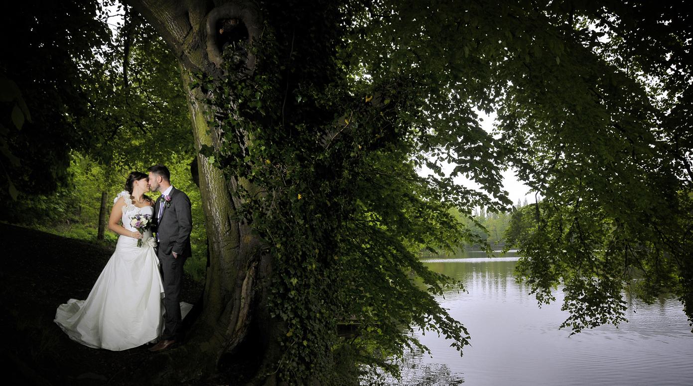 Bride and groom by Lymm waterside