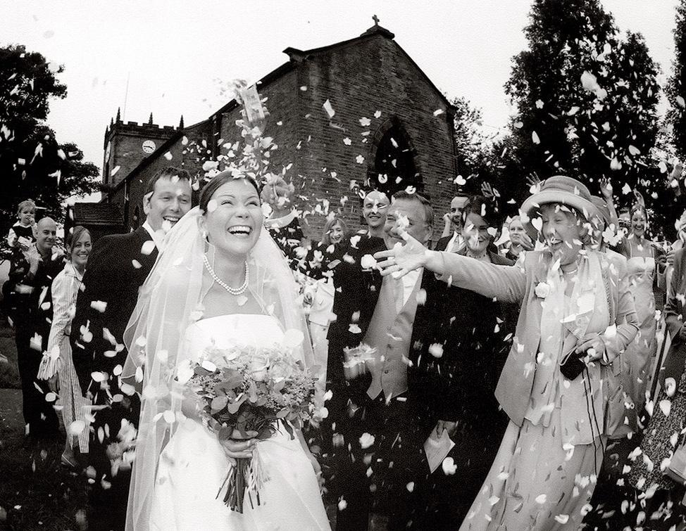 Confetti covers the bride