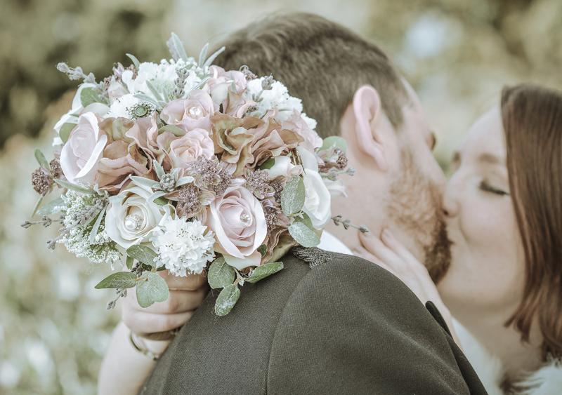 Bride, groom, kiss, bouquet